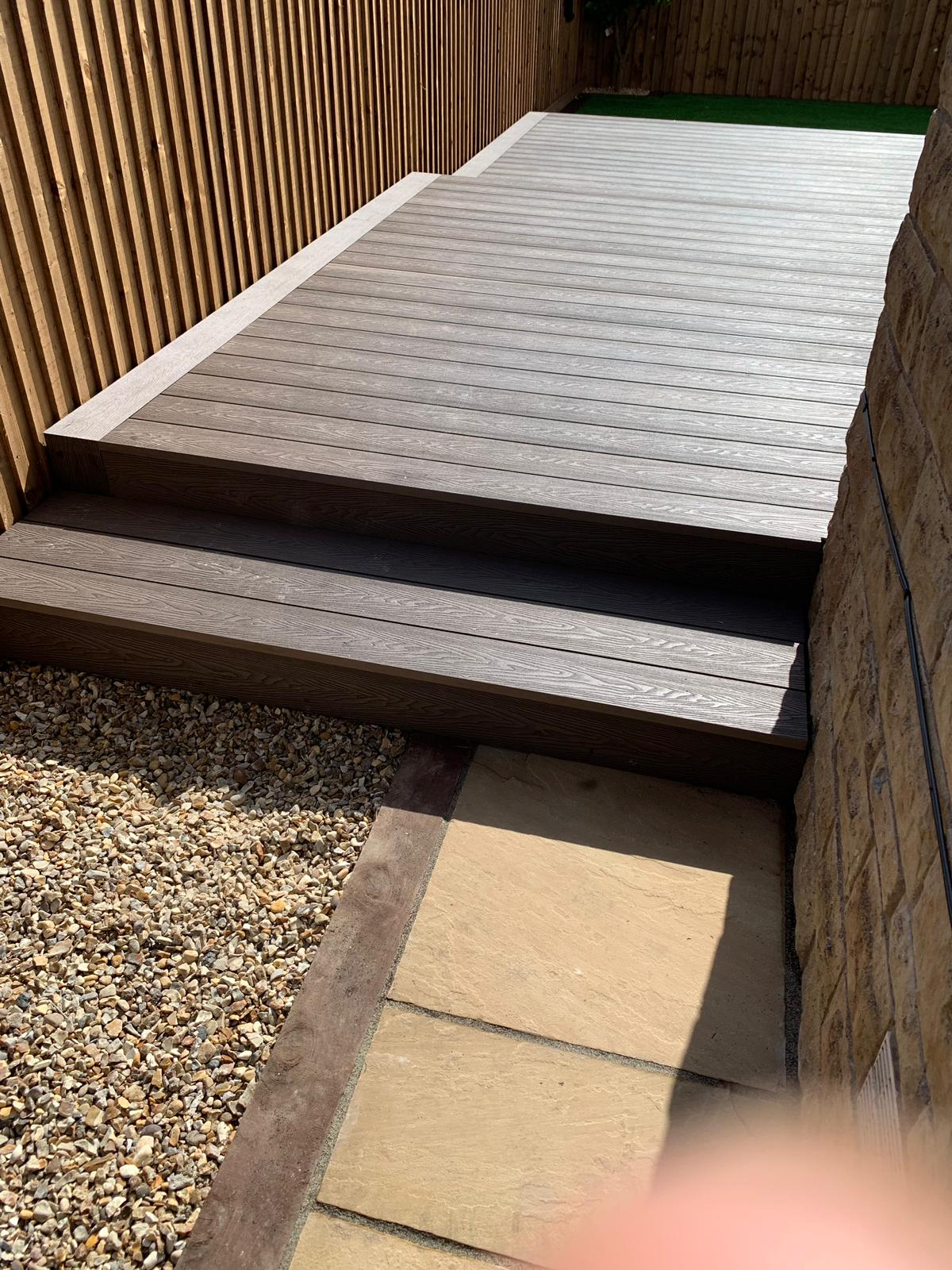 SET IN RAILWAY SLEEPERS WITH INDIAN SANDSTONE PAVING & FEATHER EDGE FENCING