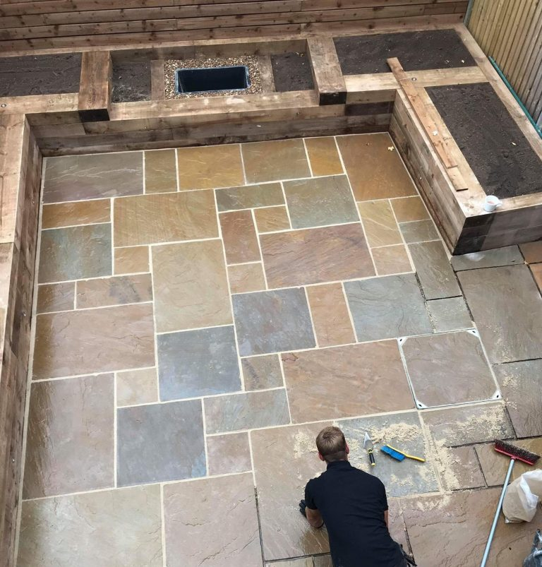 INDIAN SANDSTONE PAVING WITH RAILWAY SLEEPER RAISED BEDS