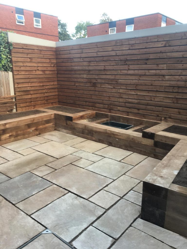 RAILWAY SLEEPER RAISED BEDS , CONTEMPORARY WALL PANEL , INDIAN SANDSTONE PAVING