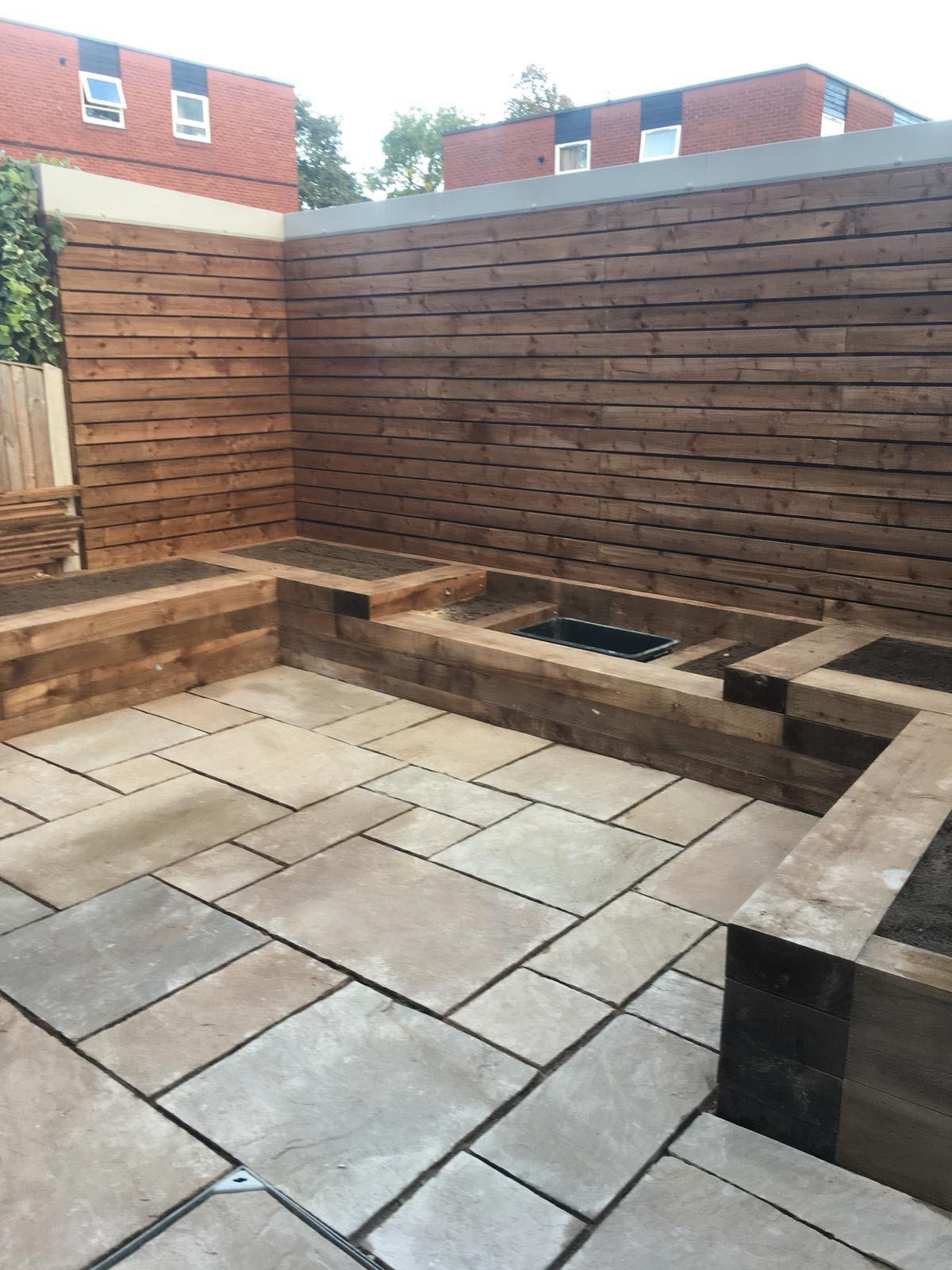 RAILWAY SLEEPER RAISED BEDS WITH INDIAN SANDSTONE PAVING