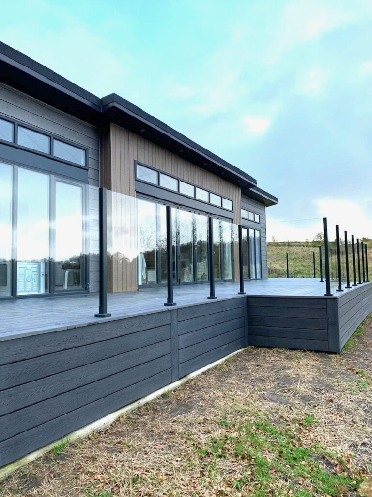 Heritage Grey Deep Embossed Composite Decking with Glass Balustrades