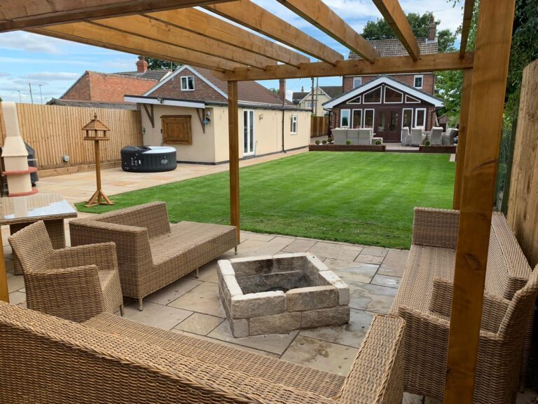 Rippon Indian Sandstone Paving with Resin Pointing with bespoke built fire pit and Pergola