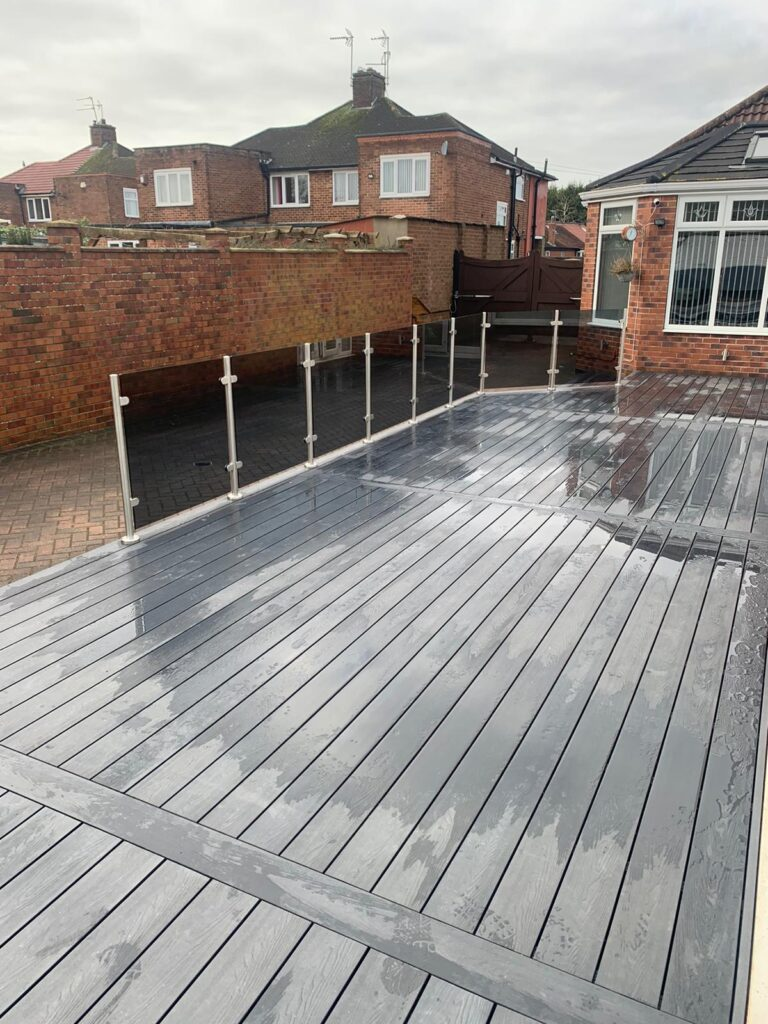 Heritage Grey Deep Embossed Composite Decking with Smoked  Glass Balustrades