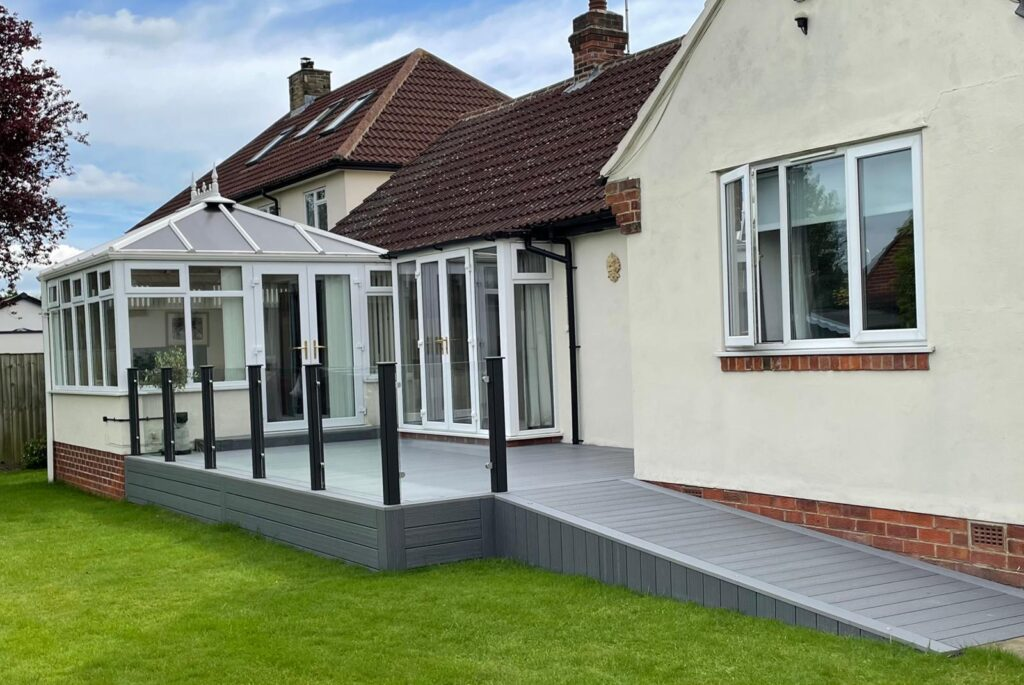HERITAGE GREY DEEP EMBOSSED COMPOSITE DECKING WITH WHEELCHAIR ACCESS RAMP
