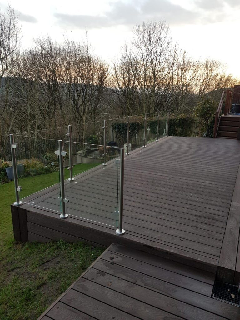 Mahogany Brown composite decking with glass balustrades