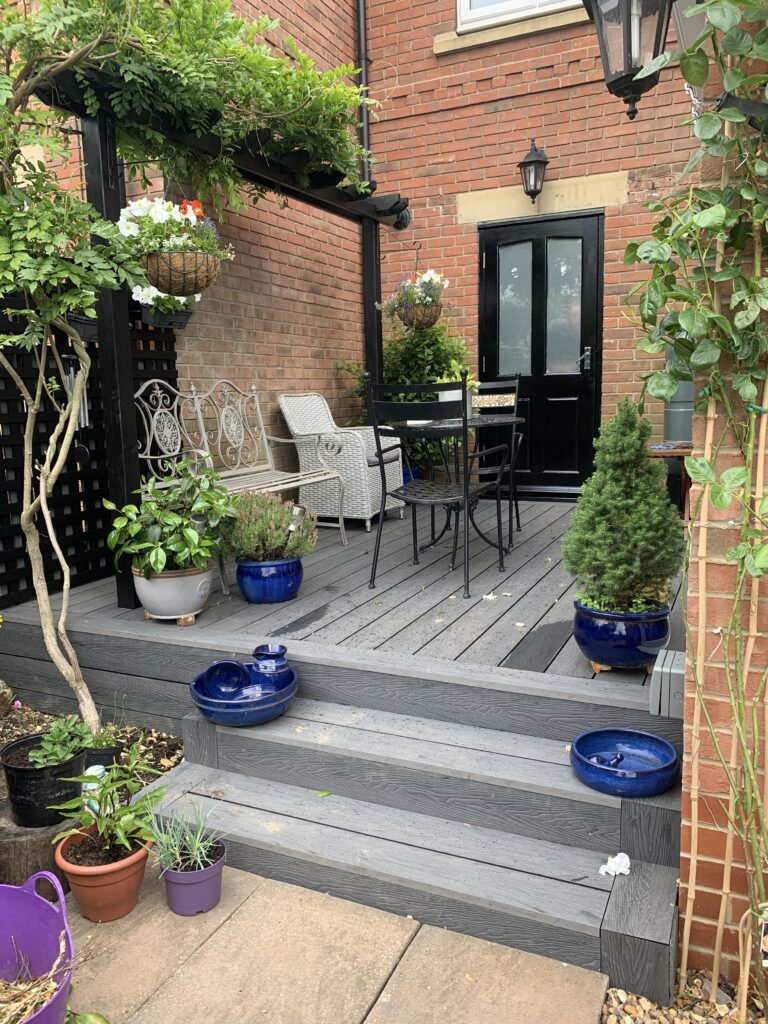 Heritage Light Grey Deep Embossed Composite Decking with added Pergola