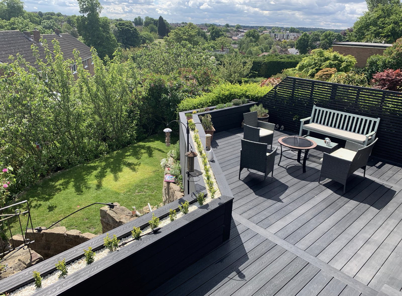 HERITAGE DARK CHARCOAL DEEP EMBOSSED COMPOSITE DECKING WITH PLANTERS AND CONTEMPORARY FENCE SCREEN