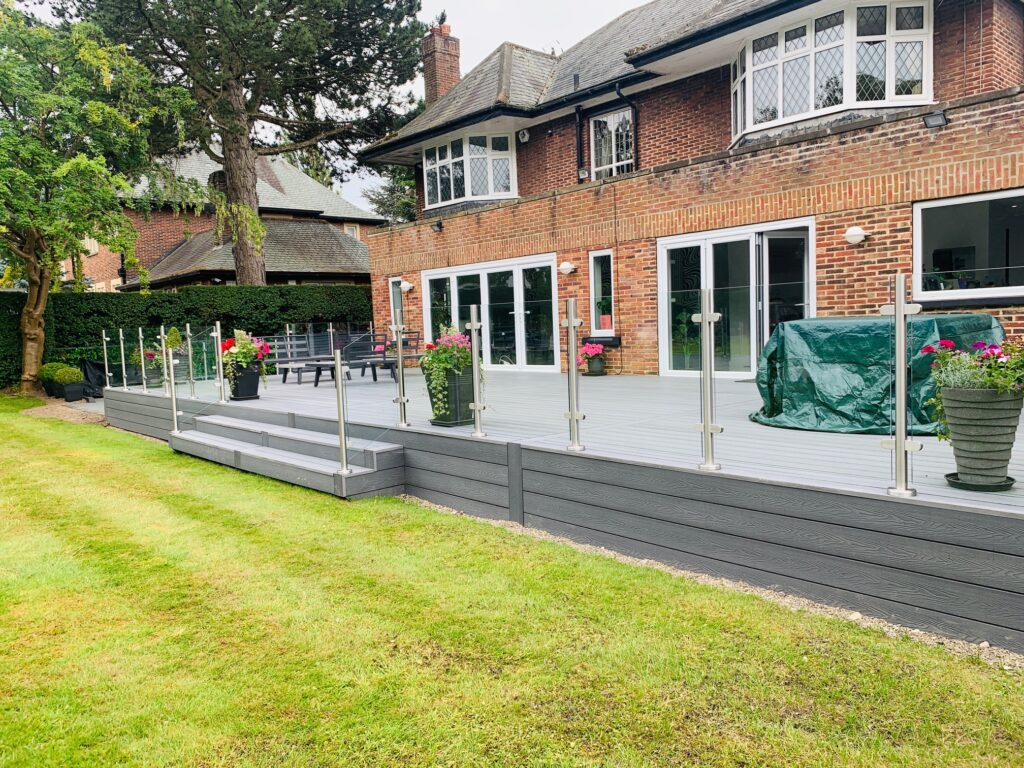 Heritage Light Grey Deep Embossed Composite Decking with Glass Balustrades