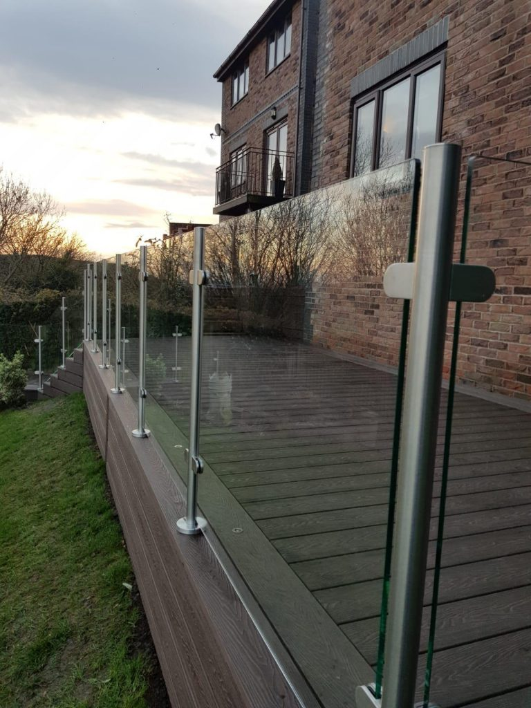 Mahogany Brown Deep Embossed Composite Decking with Glass Balustrades and aluminium handrails